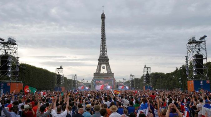 France and Portugal fans gather at Paris fan zone during a EURO 2016 final soccer match